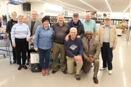 Christmas Fund Committee buying groceries for needy families